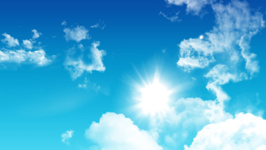 3D render of a blue sky with fluffy white clouds